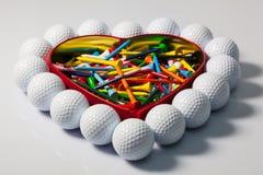 Coração das bolas de golfe e dos T Imagens de Stock