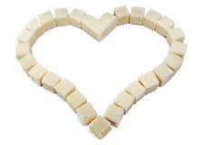 Coração das fatias do açúcar refinado branco fotografia de stock royalty free