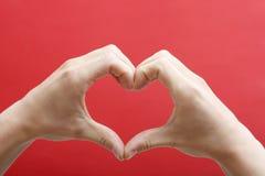 Coração das mãos Fotografia de Stock