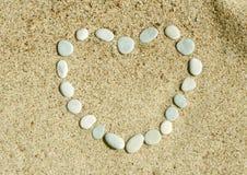 Coração das pedras na areia Foto de Stock Royalty Free