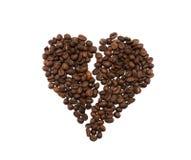Coração de Brocken feito de feijões de café Imagens de Stock Royalty Free