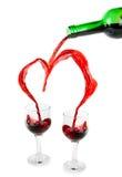 Coração de derramar o vinho vermelho fotografia de stock