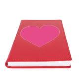 Coração de papel cor-de-rosa no livro vermelho isolado no branco fotografia de stock royalty free
