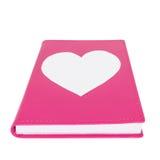 Coração de papel no livro cor-de-rosa isolado no fundo branco fotos de stock royalty free