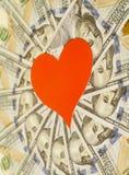 Coração de papel vermelho e cem notas de dólar Foto de Stock Royalty Free