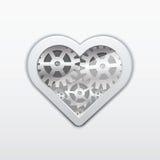Coração de uma roda de engrenagem em um fundo cinzento. Fotografia de Stock Royalty Free