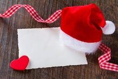 Coração do cartão do chapéu de Christmas do pai foto de stock