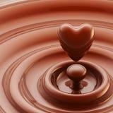 Coração do chocolate como um fundo líquido da gota Fotos de Stock Royalty Free