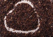 Coração do quadro da beira da baga do arroz Fotografia de Stock Royalty Free