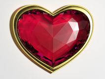 Coração do rubi em um quadro do ouro Fotos de Stock