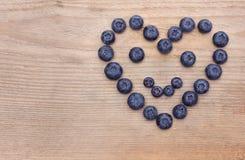 Coração do sorriso das uvas-do-monte Fotos de Stock
