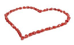 Coração do Valentim feito de sementes da romã Fotografia de Stock Royalty Free