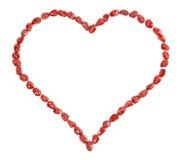 Coração do Valentim feito de sementes da romã Imagens de Stock