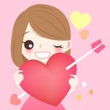 Coração do vermelho da posse da menina Foto de Stock