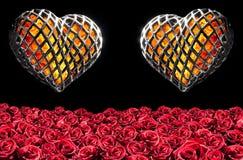 Coração dois flamejante em uma gaiola fotos de stock