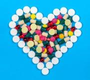 Coração dos comprimidos Fotografia de Stock