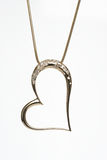 Coração dourado colar dada forma Imagens de Stock Royalty Free