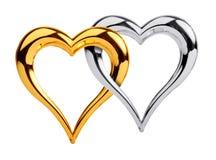 Coração dourado e de prata junto Fotografia de Stock Royalty Free
