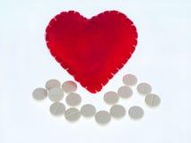 Coração e comprimidos Imagem de Stock