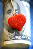 Coração e dinheiro Fotos de Stock