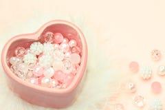 Coração e grânulos fotografia de stock