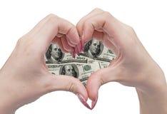 Coração e mãos do dinheiro Fotografia de Stock