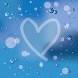 Coração e pingos de chuva desenhados mão no vidro Fotografia de Stock Royalty Free