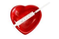 Coração e seringa Foto de Stock Royalty Free