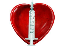 Coração e seringa Imagens de Stock Royalty Free
