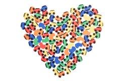 Coração em um fundo branco de máquinas pequenas imagem de stock royalty free