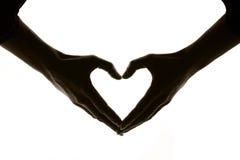 Coração em um fundo branco feito pelas mãos Fotografia de Stock
