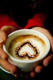 Coração em uma chávena de café Imagem de Stock Royalty Free