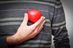 Coração em uma mão Foto de Stock