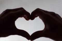 Coração em uma mão Imagens de Stock Royalty Free