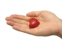 Coração em uma palma fotografia de stock