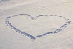 Coração encantador na neve branca Imagem de Stock