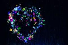 Coração feito de borboletas multi-coloridas ilustração royalty free