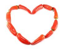 Coração feito de pimentas vermelhas Imagens de Stock Royalty Free