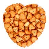 Coração feito dos bolinhos salgados Foto de Stock Royalty Free
