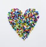 Coração feito dos grânulos fotos de stock royalty free