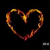 Coração flamejante isolado no fundo preto Símbolo do amor Fotografia de Stock