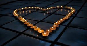 Coração morno da vela Fotos de Stock Royalty Free
