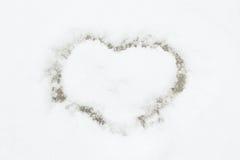 Coração na neve Imagens de Stock