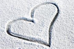 Coração na neve Fotos de Stock