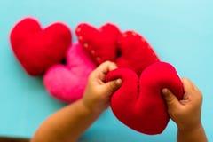 Coração nas mãos em nosso fundo do coração fotos de stock royalty free
