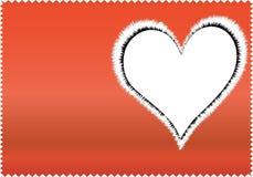 Coração nevado no pano vermelho Fotografia de Stock