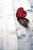 Coração no fundo de madeira Imagem de Stock