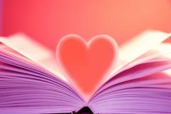 Coração no livro Fotografia de Stock