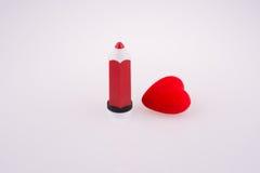 Coração perto de uma pena Fotografia de Stock