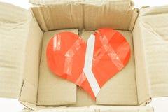 Coração ruim dentro da caixa de dano fotografia de stock royalty free